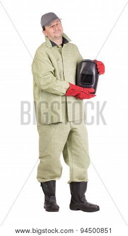 Worker with welding mask.