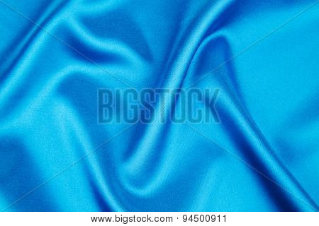 Folds of deep blue silk texture.