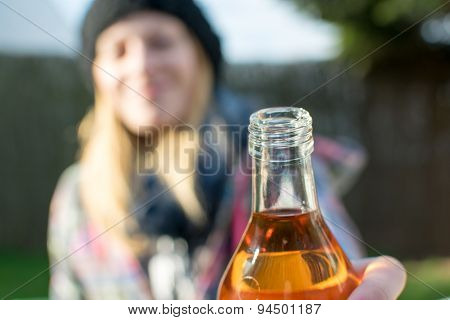girl offering a drink