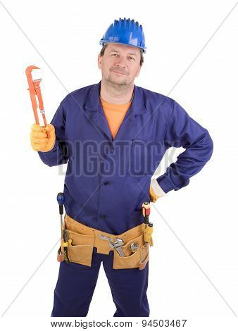 Worker in hard hat holding gas wrench.