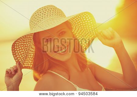Beauty Happy Smiling Woman In Hat At Sea At Sunset On Beach