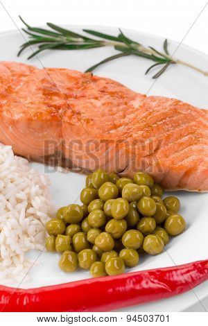 Grilled salmon fillet with risotto.