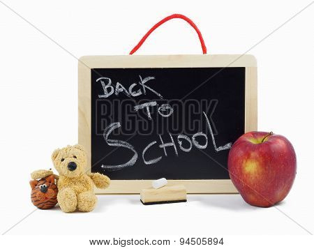 BACK TO SCHOOL writing on a wooden chalkboard