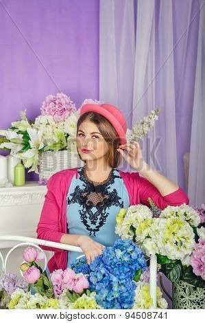 She Straightens Her Hat Surrounded By Flowers
