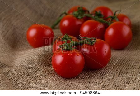 Red Small Cherry Tomatoes Placed On Big Jute Cloth