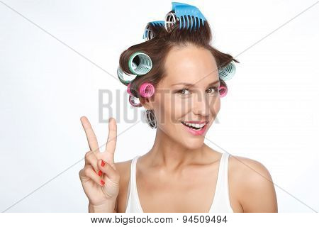 Portrait of a woman with hair rollers