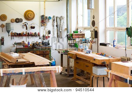 Work Bench With Tools In The Carpenter's Workshop