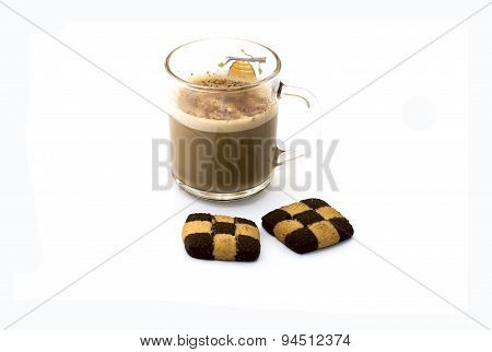 The Transparent Mug About A Cappuccino And Two Checkered Cookies