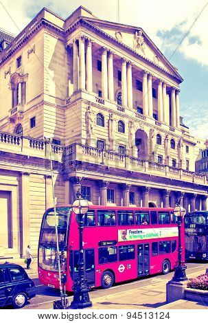 LONDON, UK - JUNE 30, 2014: Bank of England. Square and underground station with red bus on foregrou