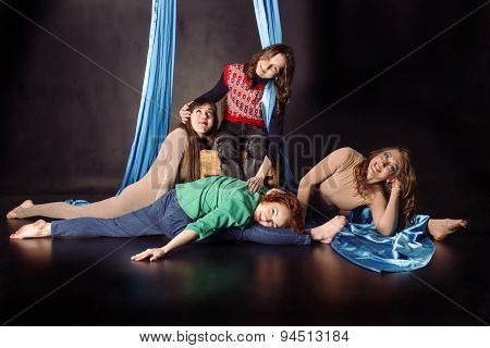 Four aerial gymnasts with silk