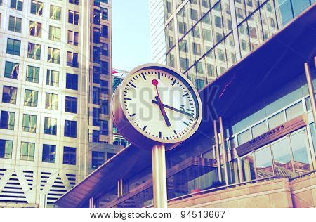 LONDON, CANARY WHARF UK - JUNE 2, 2015:  Modern architecture of Canary Wharf business aria and clock