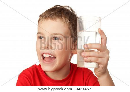 Little Boy Laughs And Holds In His Hand Glass With Water
