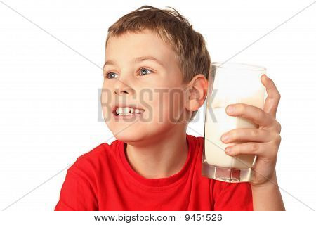 Little Boy In Red Sports Shirt Laughs And Holds Container Of Milk In Hand