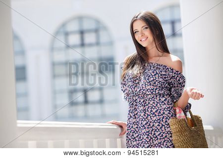 Attractive brunette with a bag in a big city.