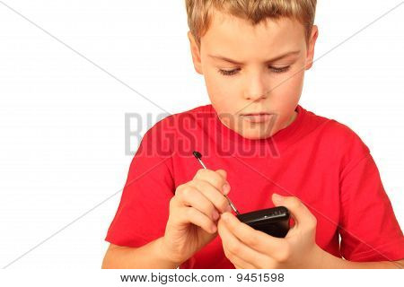 Smart Small Boy In Red Sports Shirt Writes Note In Telephone