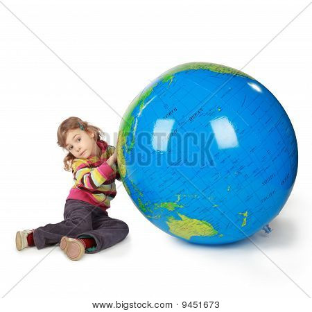 Small Girl With Enormous Globe Select Place, Where She Will Live