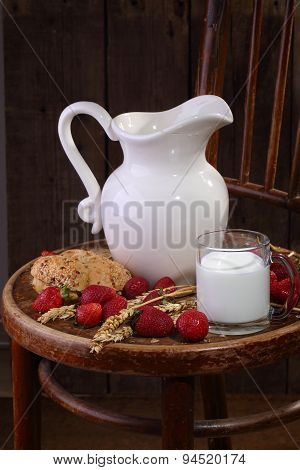 Milk In A Transparent Mug, Bread And A Ripe Strawberry