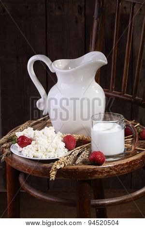 Light Morning Meal From Cottage Cheese With A Strawberry And Milk