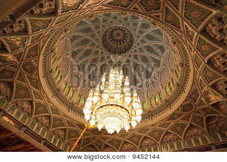 big beautiful lustre in a hall of Grand Mosque in Oman.