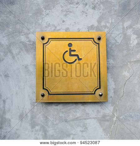 Disabled Handicap Icon Sign Made From Gold Metal Board