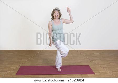 Woman Exercises Yoga