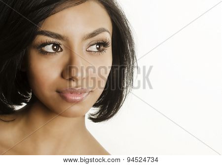 Attractive young woman looking to one side