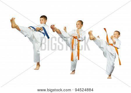 Collage of three athletes beat kick mae-geri