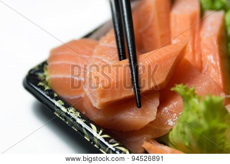Piece Of  Imitation  Crab  With Chopstick Closeup  Isolated