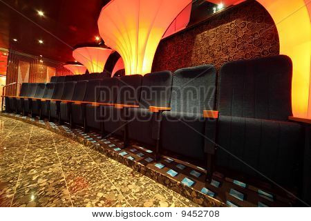 illuminated hall inside of ship. row of comfortable seats