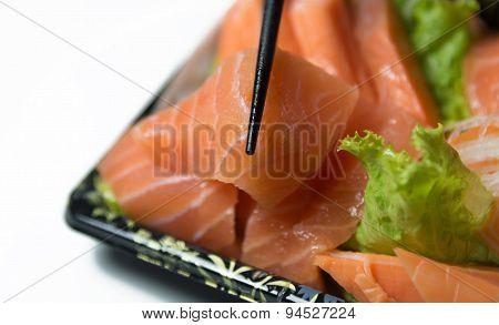 Chopstick Grab A Slice Of Salmon Sashimi Closeup