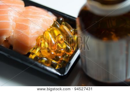 Sushi Served With Piles Of Fish Oil Capsules With Brown Bottle Isolated