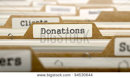 Donations Concept with Word on Folder.