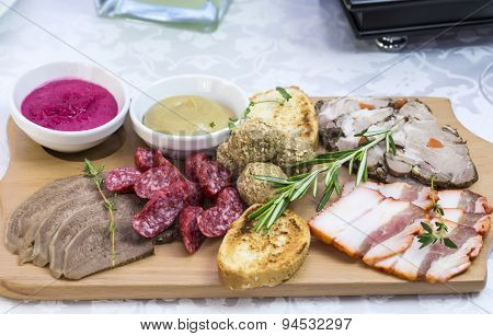 wooden dish with bacon and sausage