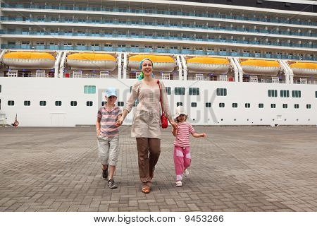 Mother, Daughter And Son Walking In Dock And Holding For Hands, Big Cruise Ship On Background