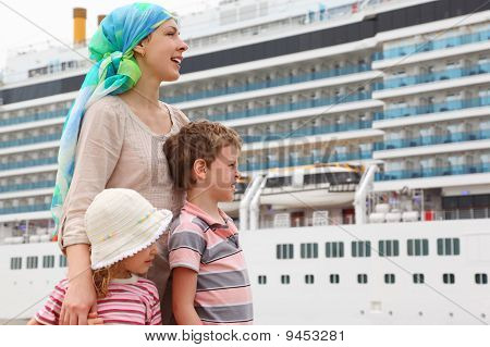 Mother, Son And Daughter In Dock, Looking Right, Big Cruise Ship On Background