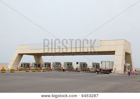 Security Check-point On Road To Port And Big Asphalt Area
