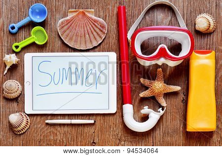 high-angle shot of a rustic wooden table full of summer stuff, such as a starfish, some seashells, a diving mask and a snorkel, a bottle of sunblock and a tablet with the word summer written in it