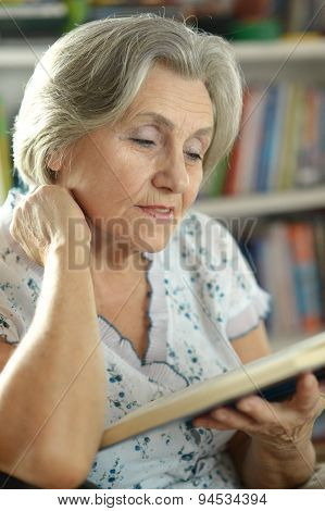 elderly woman with book