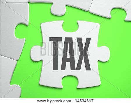 Tax - Jigsaw Puzzle with Missing Pieces.