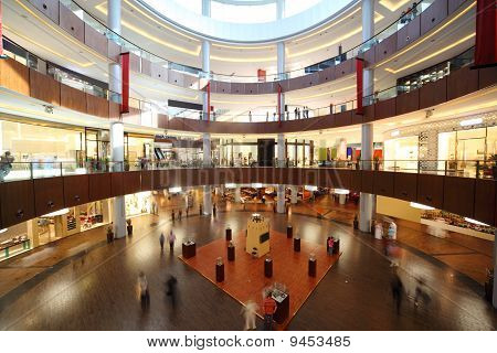 Circle Shopping Center With Four Floors And Columns, People In Motion