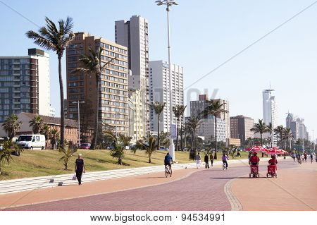 Pedestrians On Paved Promenade On Durban Beach Front