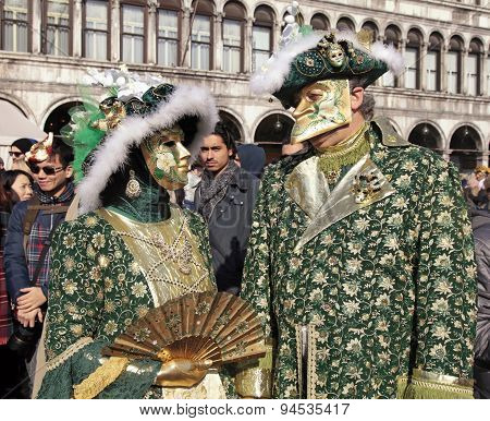 Masked Persons In Costume On San Marco Square During The Carnival In Venice, Italy.
