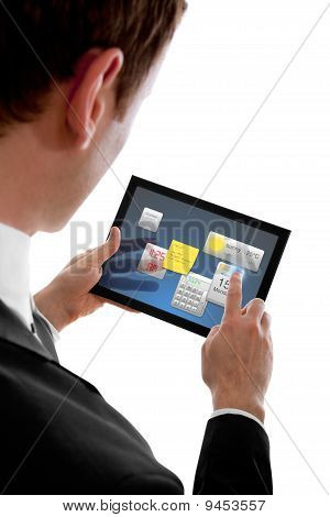 Businessman Holding A Touchpad Pc Using Little Widget Programms