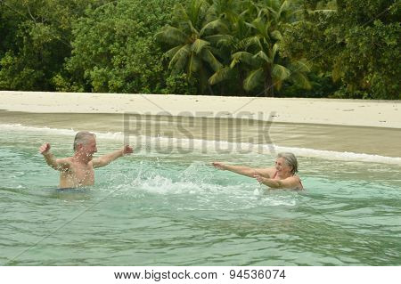 Elderly couple  at tropical beach
