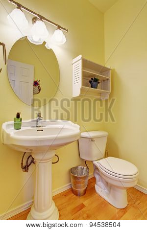 Cute Half Bathroom With Yellow Walls.