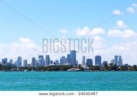 Cloudy sky over the water and Miami city Florida.