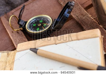 Compass And Notepad With Pen