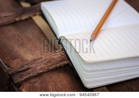 Notepad With Pen On Wood Table