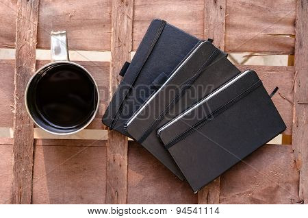 Cup Of Coffee With Notepads