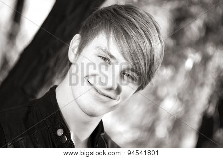 attractive, smiling guy on nature. close-up portrait